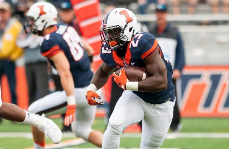 Illinois running back Henry Enyenihi (23) runs the ball during the fourth quarter against Western Illinois Saturday, Sept. 12, 2015, at Memorial Stadium in Champaign. Illinois won 44-0.