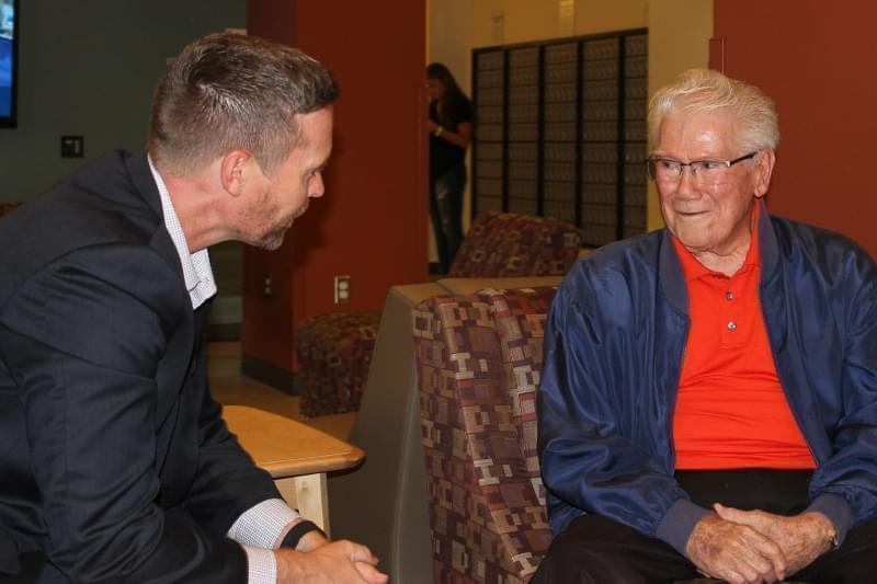 U.S. Rep. Rodney Davis visits with Tim Nugent at Nugent Hall on the U of I campus Saturday.