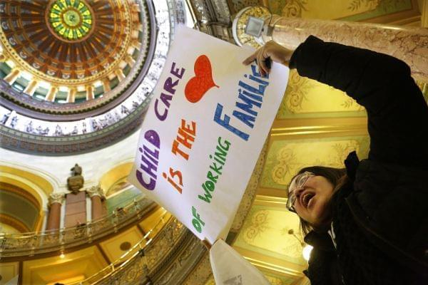 Erica Hurtado of Chicago, participates in a rally to save Illinois child care programs for children and working families in the rotunda at the Illinois State Capitol Thursday, Feb. 19, 2015, in Springfield, Ill.
