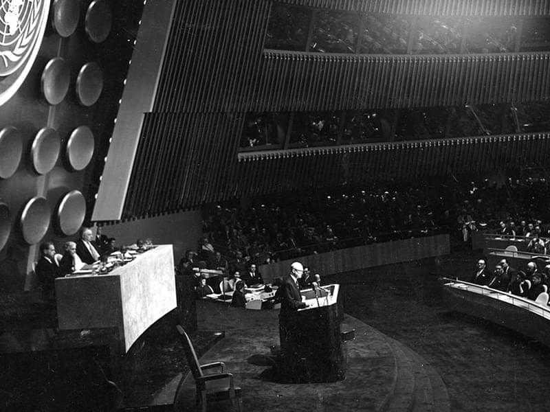 President Eisenhower speaking at a podium at the United Nations