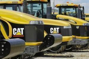 this June 20, 2012 file photo, earth-moving tractors and equipment made by Peoria, Ill.-based Caterpillar Inc. are seen in Clinton, Ill.