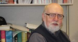 """John Frayne, seated at his desk at WILL-FM. Frayne is stepping down as host of """"Classics by Request"""" after 30 years, but will continue with """"Classics of the Phonograph""""."""