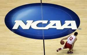 In this March 26, 2014, file photo, Wisconsin's Traevon Jackson dribbles past the NCAA logo during practice at the NCAA men's college basketball tournament in Anaheim, Calif