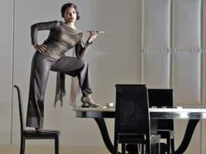 A woman standing on furniture