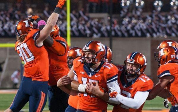 Illinois place kicker Taylor Zalewski is congratulated by teammates after kicking the go ahead extra-point in the closing seconds of Illinois' 14-13 win over Nebraska in Champaign Saturday.