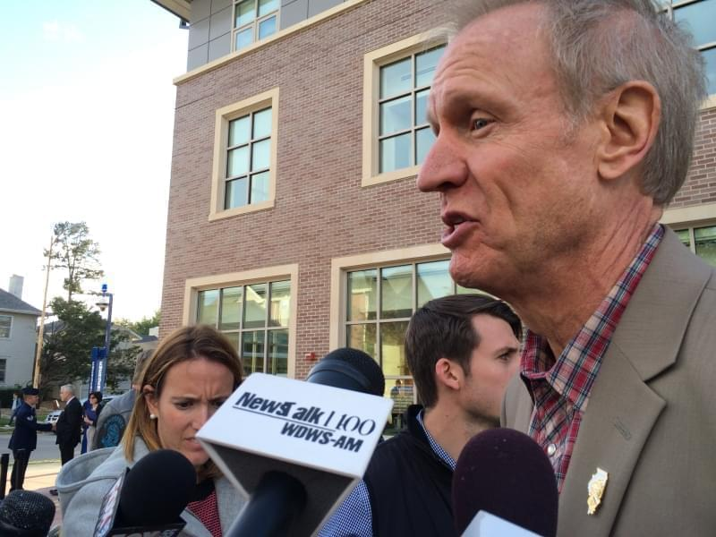 Gov. Bruce Rauner talks with media after celebrating the opening of a new Veterans Center on the U of I campus Oct. 2. Rauner appeared at U of I the day after college presidents sent the governor a letter asking for state support of universities.