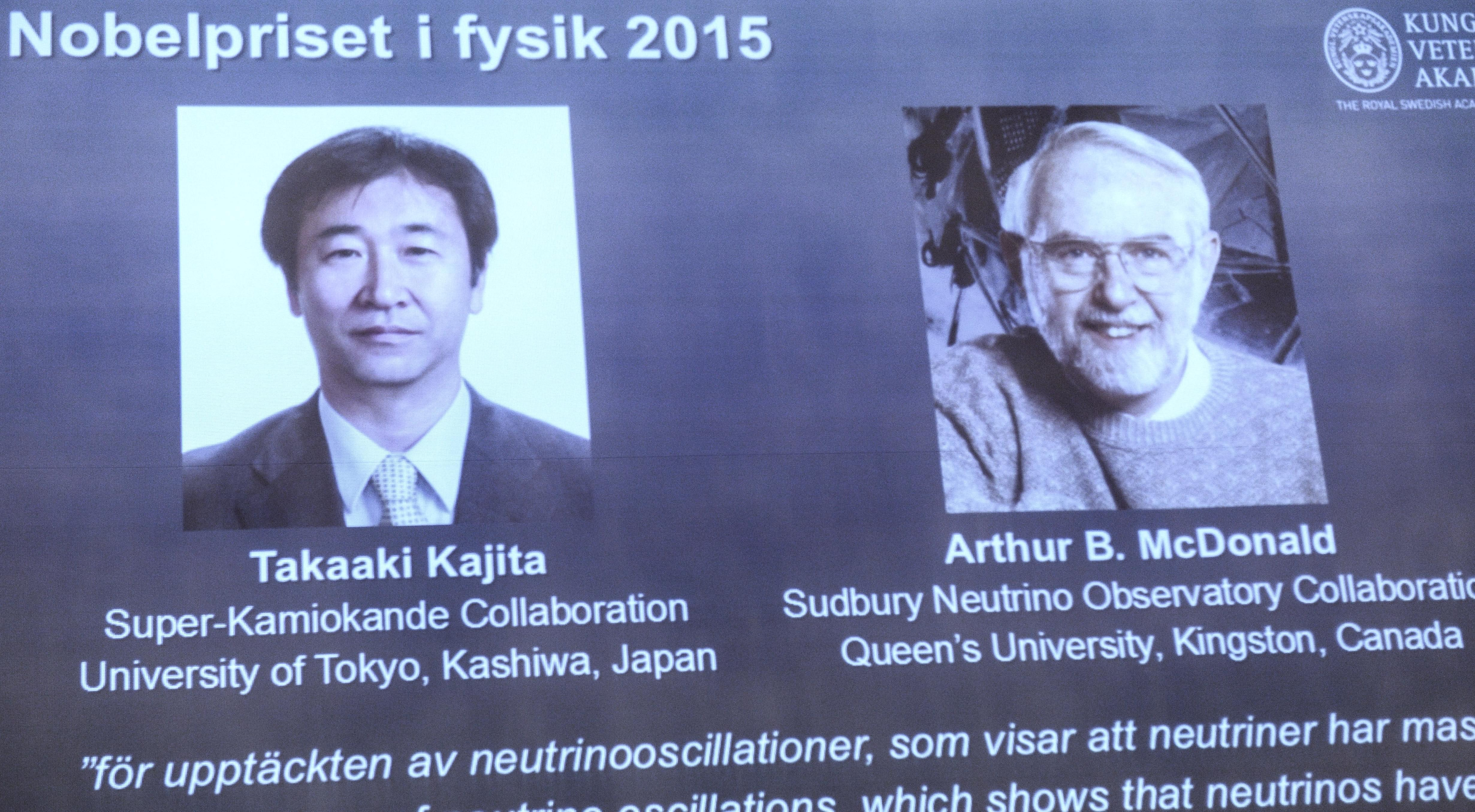 A screen shows the winners as members of the Nobel Assembly announce the winner of the 2015 Nobel Prize in physics, in Stockholm Tuesday