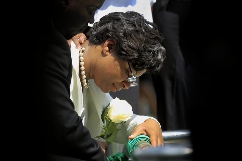 Sandra Bland's sister Sharon Cooper kneels at Bland's burial site at the Mt. Glenwood Memorial Gardens West cemetery Saturday, July 25, 2015, in Willow Springs, Ill.