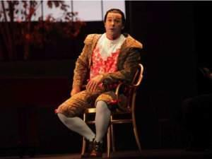 Nathan Gunn on stage as Figaro in The Barber of Seville