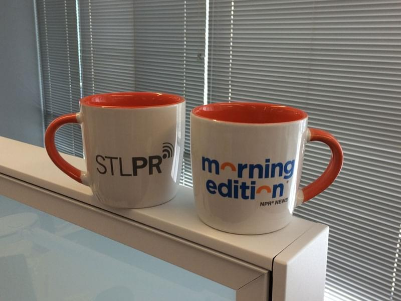 A ceramic mug with the St. Louis Public Radio and Morning Edition logos.