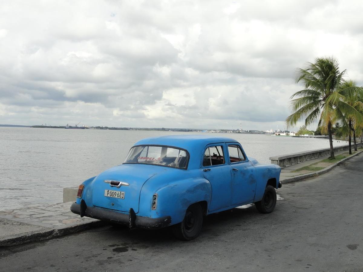 An older blue car.