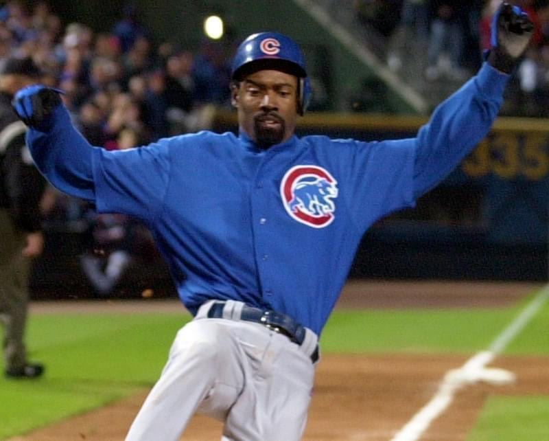 Former Chicago Cub Doug Glanville scores in the eighth inning on a Tom Goodwin sacrifice fly to tie the game 3-3 in game two of the National League Division Series at Turner Field in Atlanta Wednesday, Oct. 1, 2003 .