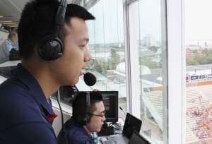 In this Sept. 5, 2015 photo, David He, left, and Bruce Lu broadcast a University of Illinois NCAA college football game from Memorial Stadium in Champaign, Ill. The two Illinois students are broadcasting Illini football games online in Mandarin Chine