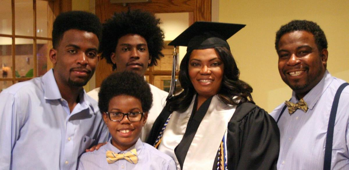 Ricca Louissaint is surrounded by her husband Roosevelt Louissaint and their three sons -- Gabe (far left), Elijah and Matthew (front) -- on graduation day.