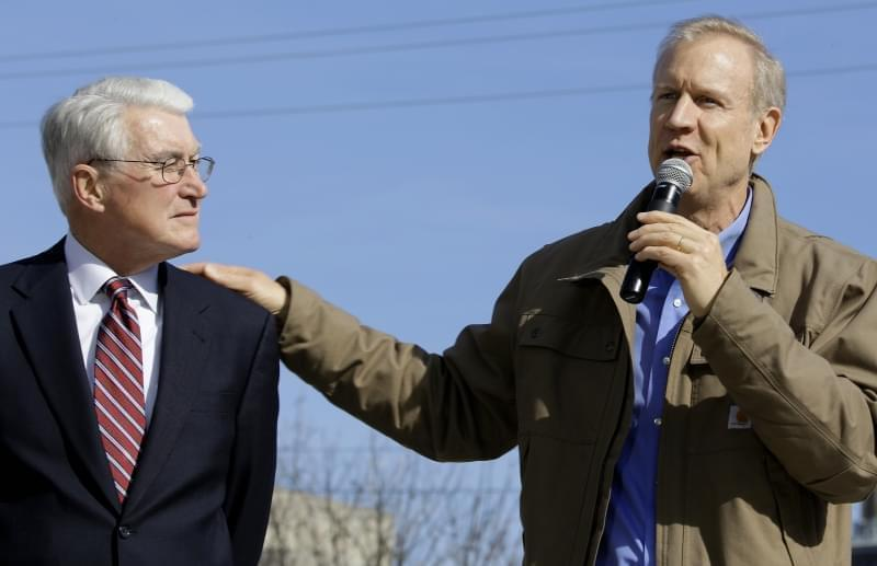 In this Nov. 3, 2014 file photo, former Governor of Illinois Jim Edgar, left, shows his support of Republican gubernatorial candidate Bruce Rauner, right, during a campaign rally in Springfield. Edgar, who ran the state from 1991 to 1999, is pressing