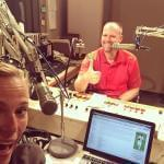 Brian Moline and Lisa Bralts, posing for a selfie in the studio.