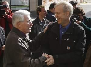 In this Nov. 7, 2014, file photo, Illinois Gov.-elect Bruce Rauner, right, greets former Republican Illinois Gov. Jim Edgar in Springfield, Ill. Pressure is building for Republican Gov. Rauner and majority Democrats to end their months-long stalemate