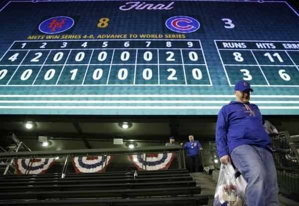 A Cubs fan leaves Wrigley Field after Game 4 of the National League baseball championship series against the New York Mets 8-3 Wednesday, Oct. 21, 2015, in Chicago.