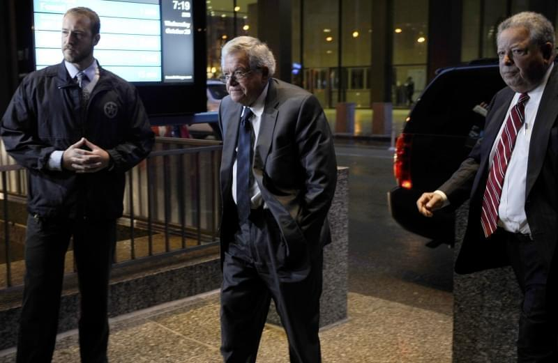 Former House Speaker Dennis Hastert, center, arrives at the federal courthouse Wednesday, Oct. 28, 2015, in Chicago, where he is scheduled to change his plea to guilty in a hush-money case that alleges he agreed to pay someone $3.5 million to hide cl
