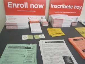 Literature on enrollment in the nation's health care law at Champaign County Health Care Consumers' office in downtown Champaign.
