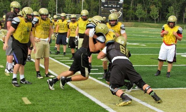 High school football team practicing