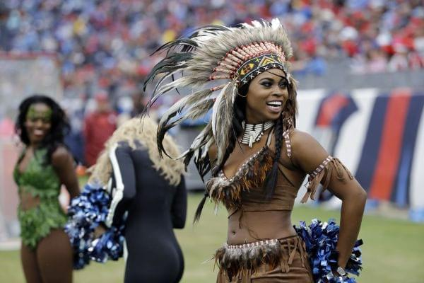 A woman dressed in a Native American headdress.