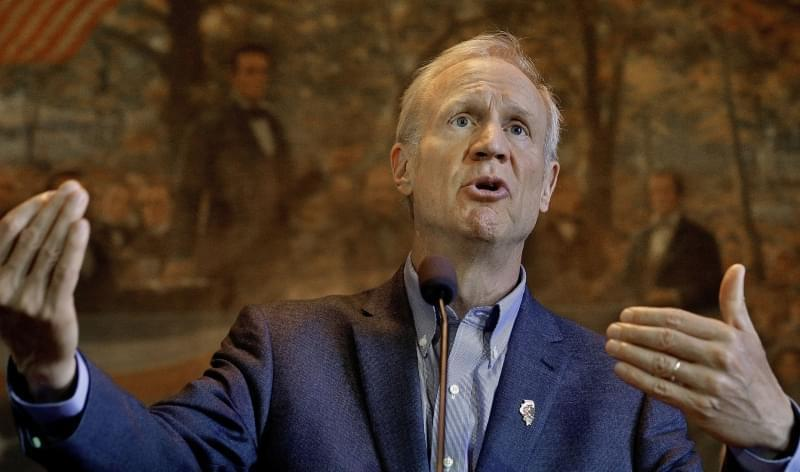 In this Oct. 16, 2015 file photo, Illinois Gov. Bruce Rauner speaks to reporters about the Illinois budget at the State Capitol in Springfield.