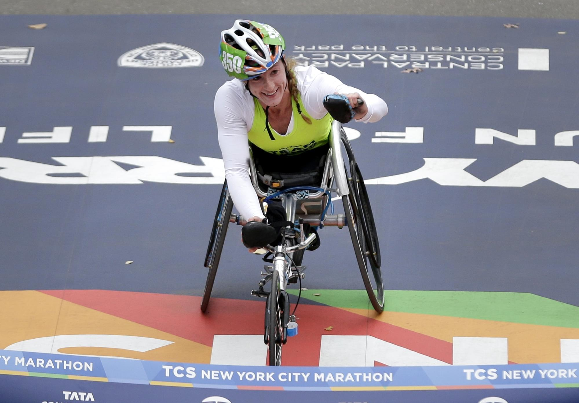 Tatyana McFadden crosses the finish line to win the women's wheelchair division of the New York City Marathon