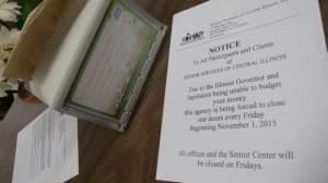 A notice at Senior Services of Central Illinois warns clients that it can no longer open on Fridays because of Illinois' partial government shutdown.