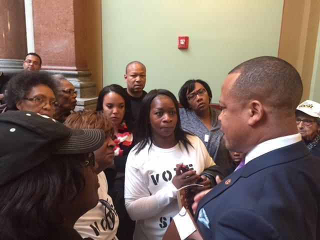 Child-care advocates confront Rep. Ken Dunkin over his decision to go back on a promise to support legislation they favored.