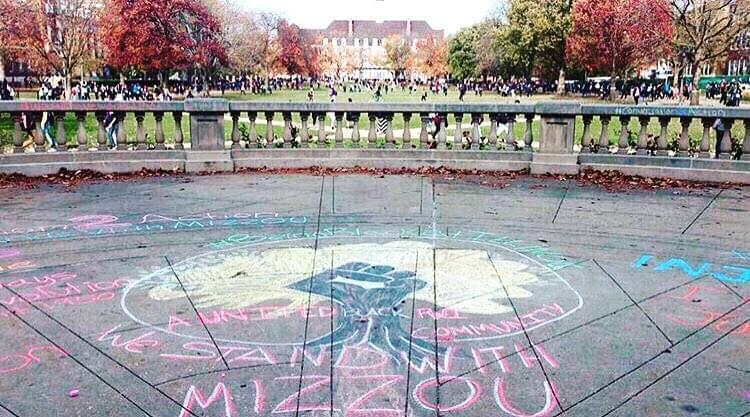 A drawing of #UIUCstandsWithMizzou near the steps of Foellinger.