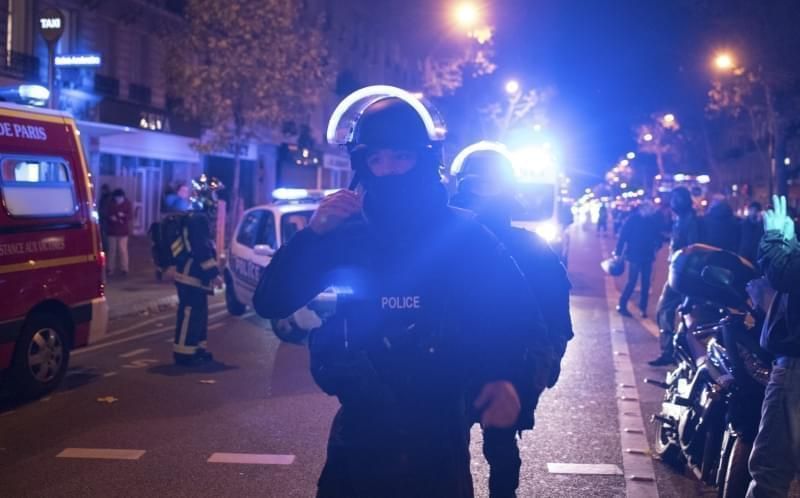 Elite police officers arrive outside the Bataclan theater in Paris, France.