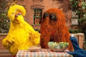 Big Bird, Mr. Snuffleupagus and Cookie Monster examine a bowl of vegetables.