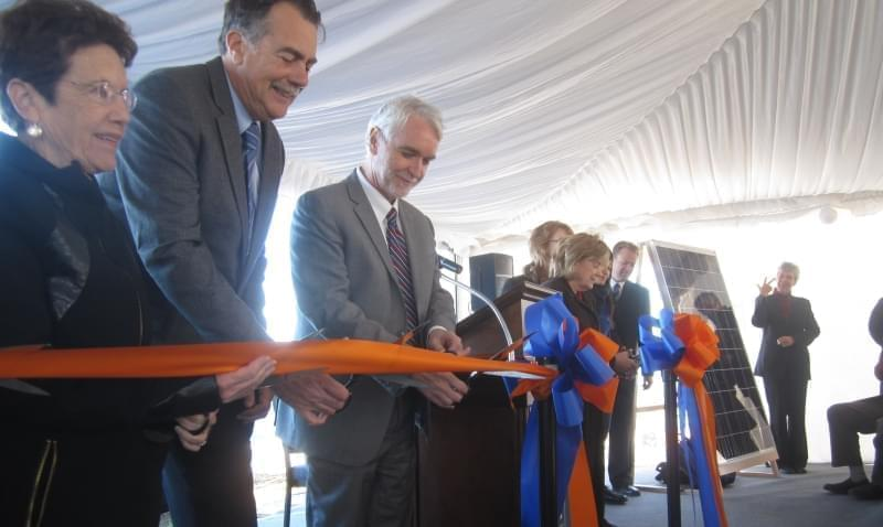 President Timothy Killeen and other dignitaries cut a ceremonial ribbon to open the new solar farm at the University of Illinois Urbana campus.