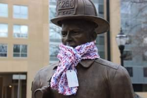 Fireman statue in West Side Park wearing one of Gretchen's scarves