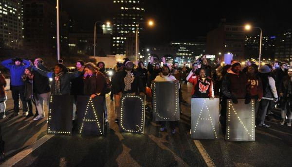 Protesters march during a demonstration for 17-year-old Laquan McDonald, Tuesday, Nov. 24, 2015, in Chicago. Chicago police Officer Jason Van Dyke, who shot McDonald 16 times last year, was charged with first-degree murder Tuesday, hours before the c