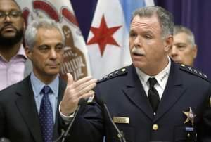 In this Nov. 24, 2015 file photo, Chicago Police Superintendent Garry McCarthy, right, speaks about first-degree murder charges against police officer Jason Van Dyke in the death of 17-year-old Laquan McDonald, as Mayor Rahm Emanuel looks on at left