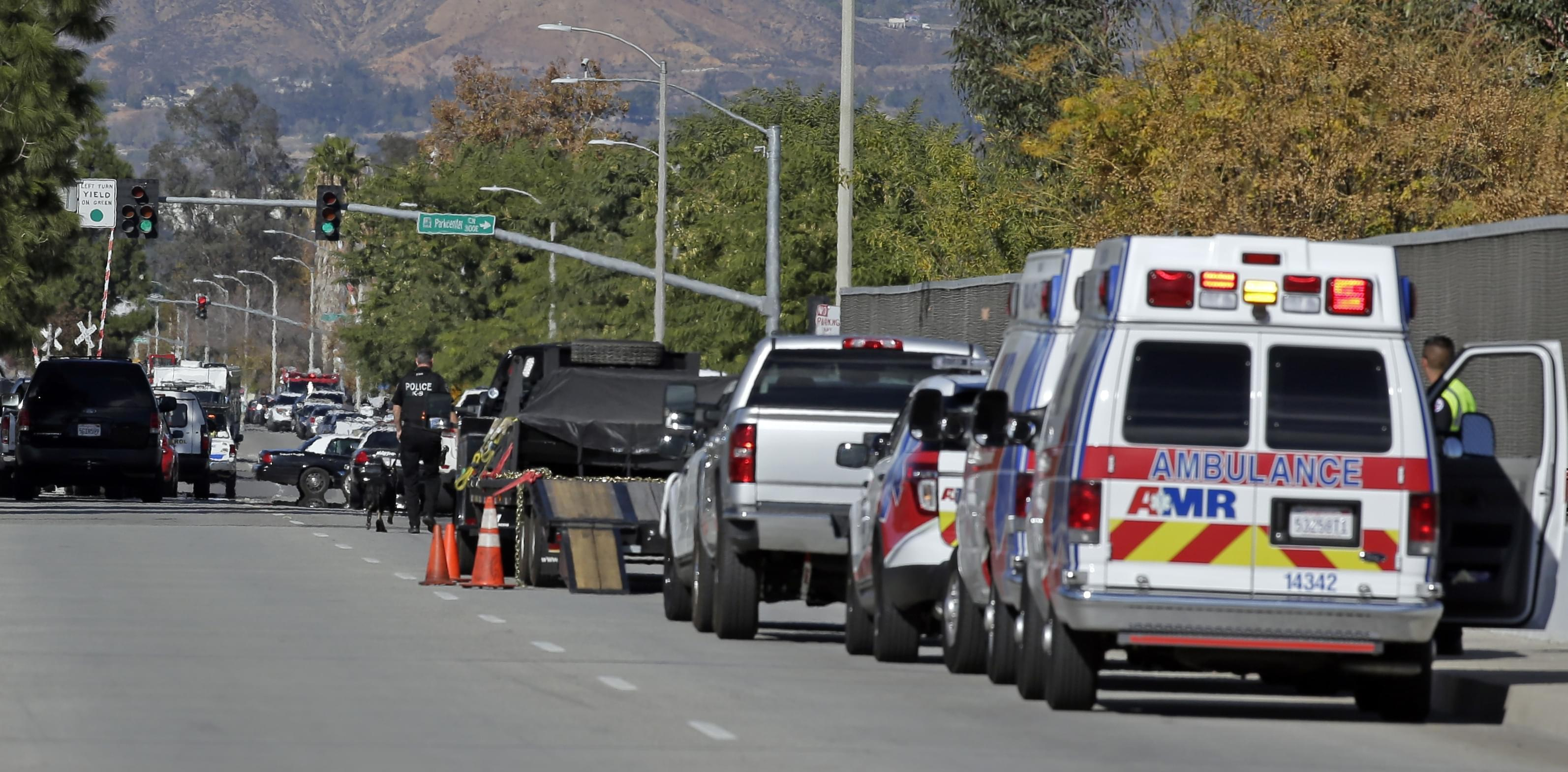 Law enforcement members line up near the the site of a mass shooting on Wednesday, Dec. 2, 2015 in San Bernardino, Calif. One or more gunmen opened fire Wednesday at a Southern California social services center, shooting several people as others lock