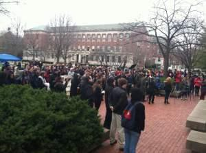 students gather outside the quad at the U of I Urbana campus to show support for black students on campus.