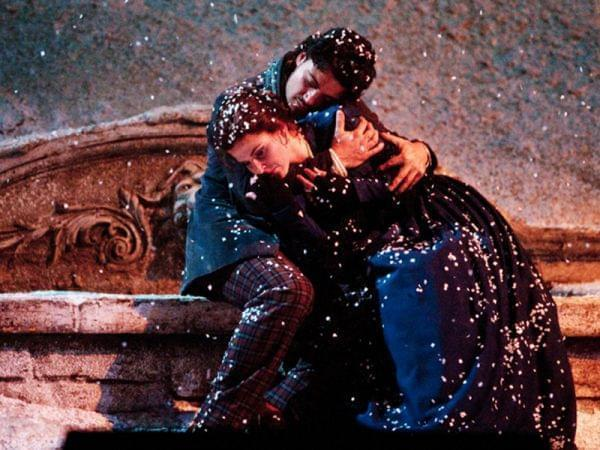 Man and woman embrace in the snow