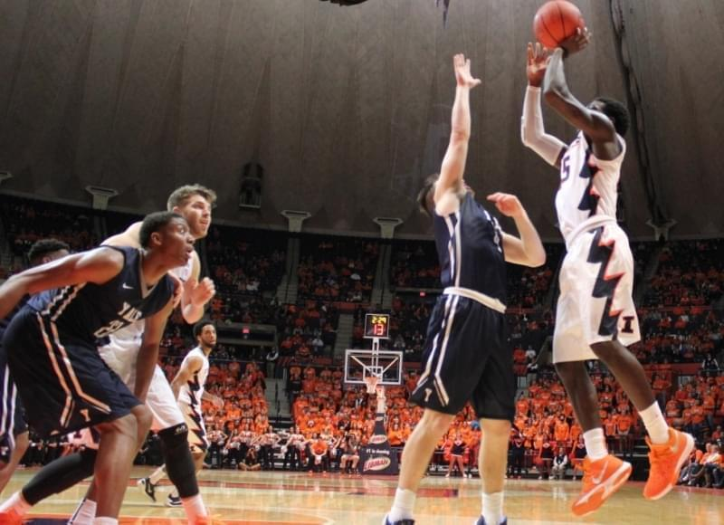 Illini men's basketball player Kendrick Nunn shooting for a basket.
