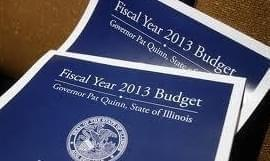 Copies of the 2013 Illinois State Budget are displayed.