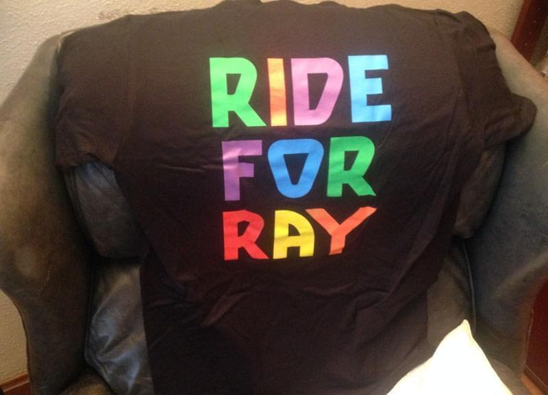 A black tee shirt reading Ride for Ray.
