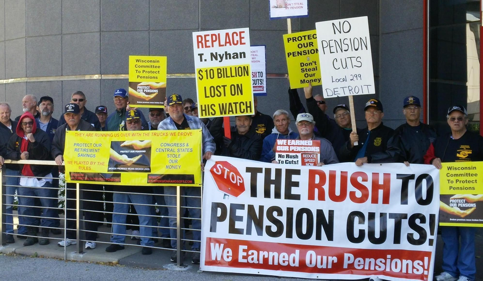 Opponents of the pension rescue plan demonstrate outside a meeting of pension fund officials.