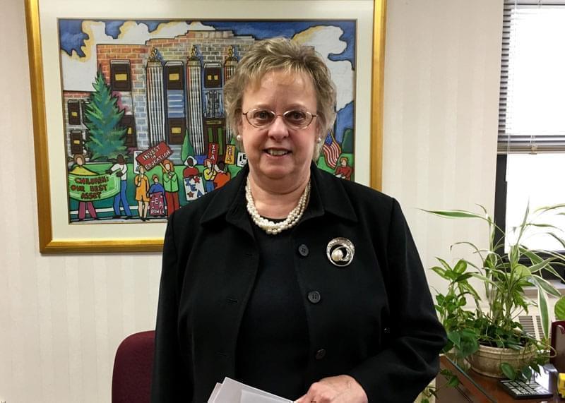 Cinda Klickna standing in an office.