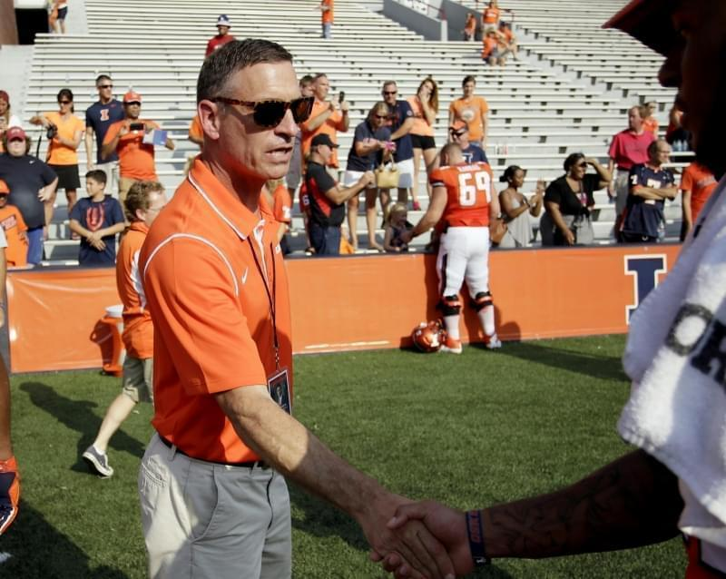 In this Sept. 5, 2015 file photo, Illinois athletic director Mike Thomas congratulates players after an NCAA college football game against in Champaign, Ill.