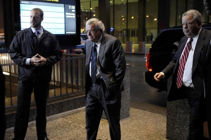 Former House Speaker Dennis Hastert, center, arrives at the federal courthouse in Chicago