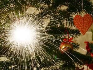 A sparkler as decoration on a christmas tree