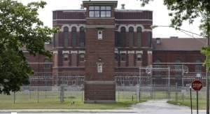 In this Aug. 20, 2008 file photo, guard tower No. 7 stands between South House to the left, and North House to the right and the cafeteria in the center of the Pontiac Correctional Center in Pontiac, Ill.