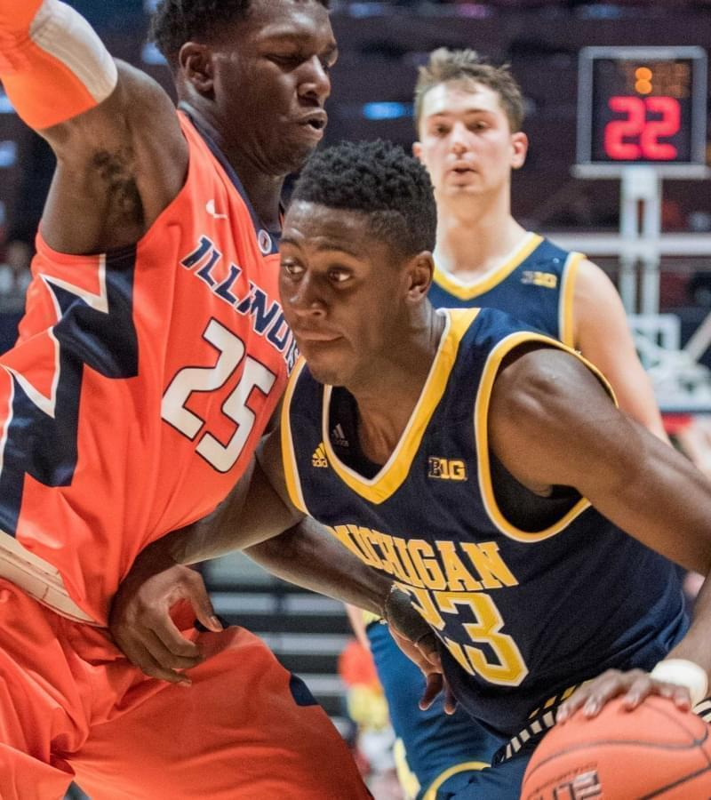 Michigan's guard Caris LeVert (23) drives into Illinois' guard Kendrick Nunn (25) during the second half of Michigan's 78-68 win over Illinois.